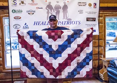 Guest and his gifted handmade quilt