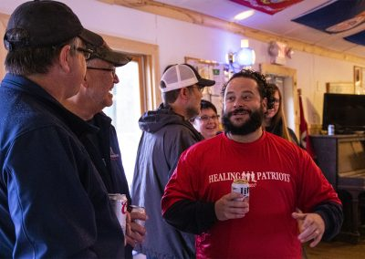 A Healing Patriots guest connecting with volunteer staff