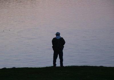 A Healing Patriots Volunteer night fishing on shore.
