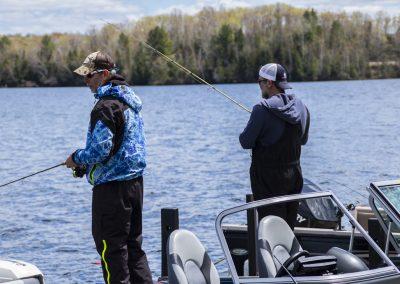 Volunteer Staff fishing off the dock