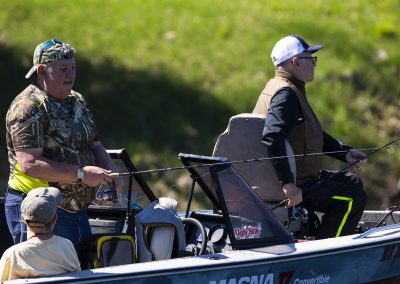 Veteran guest fishing with his volunteer boat driver and assistant