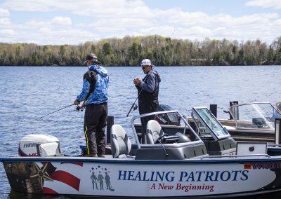 Healing Patriots Volunteer Staff fishing off the dock
