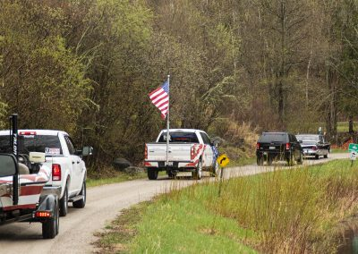 The Healing Patriots Motorcade driving slowly to the war memorial in Presque Isle, Wi.